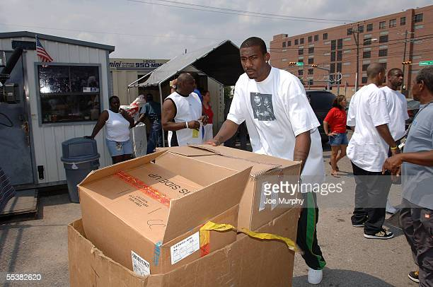 Amare Stoudemire of the Phoemix Suns brings boxes of donated items into the Star of Hope Shelter to donate to evacuees, who have ben displaced due to...