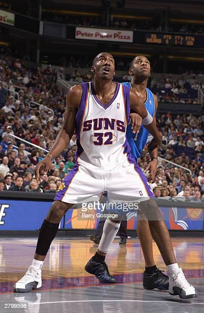 Amare Stoudemire of the Phoenix Suns and Tracy McGrady of the Orlando Magic attempt to rebound during the game at America West Arena on November 20...