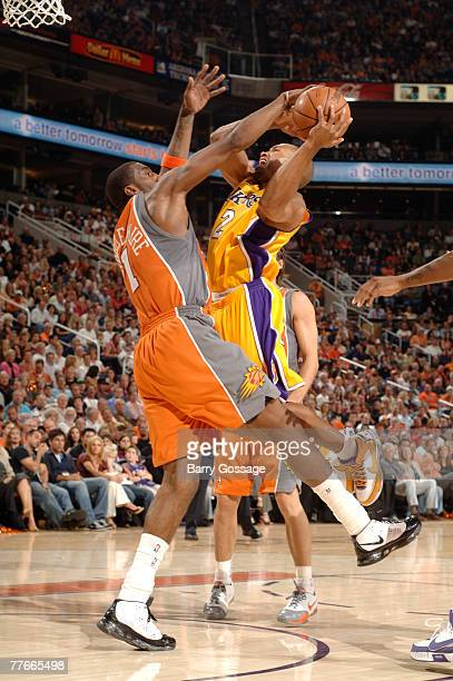 Amare Stoudemire of the Phoenix Suns blocks the shoot against Derek Fisher of the Los Angeles Lakers on November 2 2007 at the at US Airways Center...