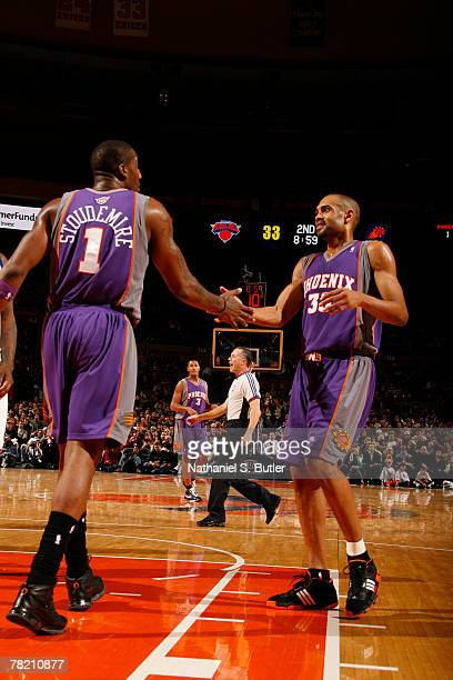 Amare Stoudemire of the Phoenix Suns celebrates with teammate Grant Hill at the game against the New York Knicks on December 2 2007 at Madison Square...