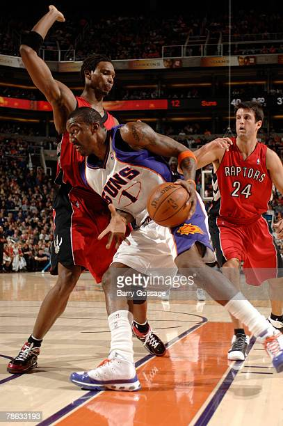 Amare Stoudemire of the Phoenix Suns drives against Chris Bosh of the Toronto Raptors in an NBA game played on December 22 2007 at US Airways Center...