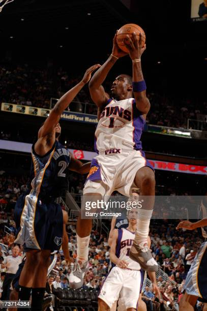 Amare Stoudemire of the Phoenix Suns drives for a shot against the Memphis Grizzlies in an NBA game played on March 26 2007 at the US Airways Center...