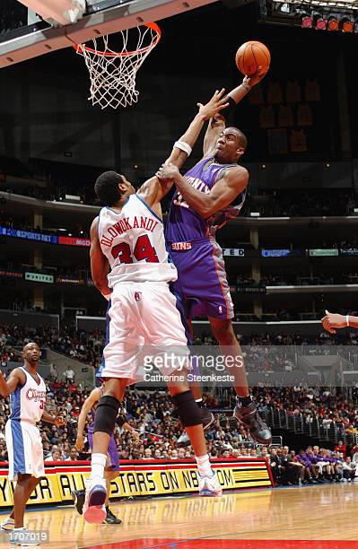 Amare Stoudemire of the Phoenix Suns drives over Michael Olowokandi of the Los Angeles Clippers during the game at Staples Center on December 20 2002...