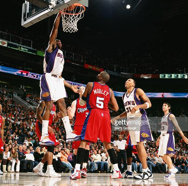 Amare Stoudemire of the Phoenix Suns dunks against Cuttino Mobley of the Los Angeles Clippers during the game at US Airways Center on December 28...
