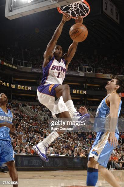 Amare Stoudemire of the Phoenix Suns dunks against the Denver Nuggets in NBA preseason action at US Airways Center on October 25 2007 in Phoenix...