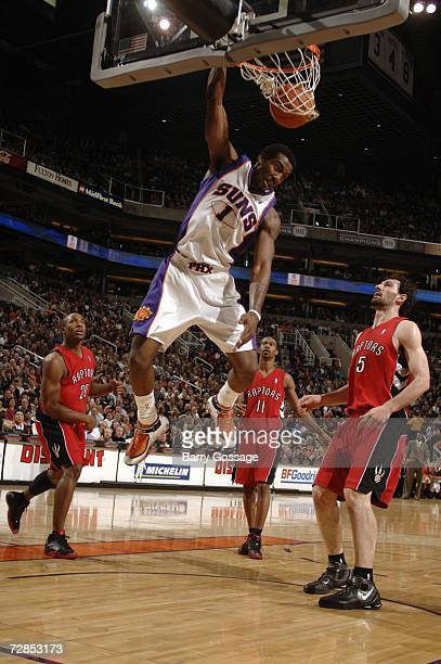 Amare Stoudemire of the Phoenix Suns dunks against the Toronto Raptors on December 19 2006 at US Airways Center in Phoenix Arizona NOTE TO USER User...