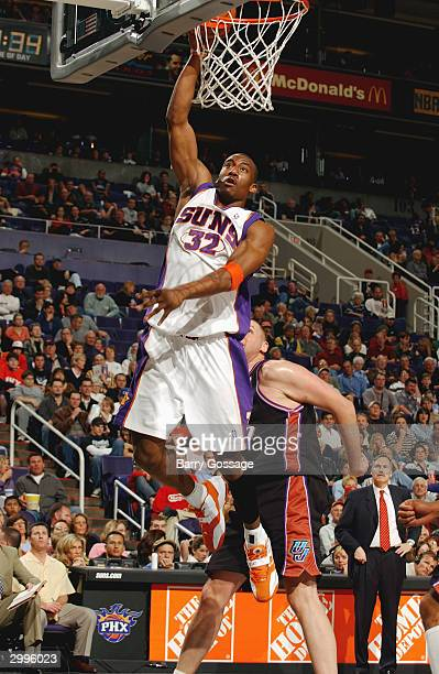 Amare Stoudemire of the Phoenix Suns dunks in front of Greg Ostertag of the Utah Jazz during the game at America West Arena on February 7 2004 in...