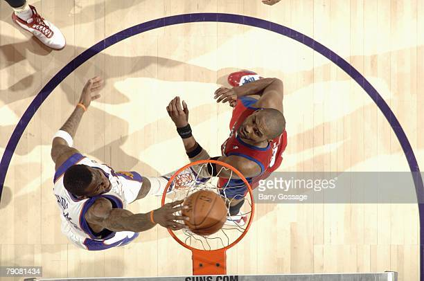 Amare Stoudemire of the Phoenix Suns dunks over Cuttino Mobley of the Los Angeles Clippers during the game at US Airways Center on December 28 2007...