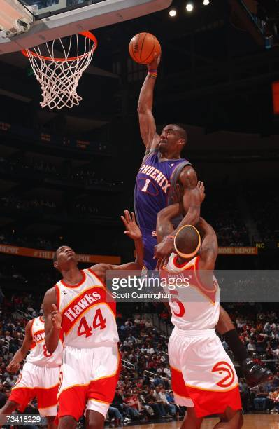 Amare Stoudemire of the Phoenix Suns dunks over Josh Smith of the Atlanta Hawks at Philips Arena on February 25 2007 in Atlanta Georgia NOTE TO USER...