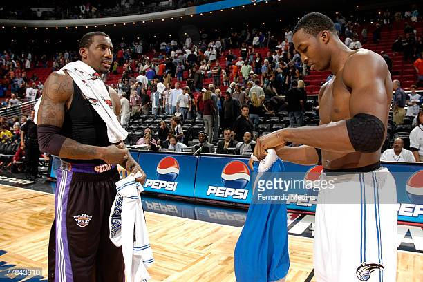 Amare Stoudemire of the Phoenix Suns exchanges jersey's after the game with Dwight Howard of the Orlando Magic at Amway Arena on November 10 2007 in...