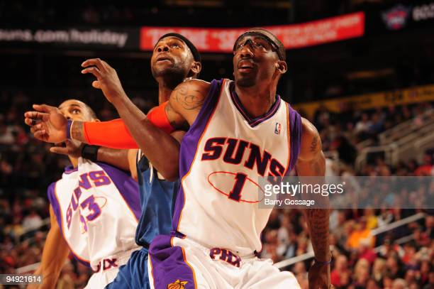 Amare Stoudemire of the Phoenix Suns fights for position with Mike James of the Washington Wizards in an NBA Game played on December 19 2009 at US...