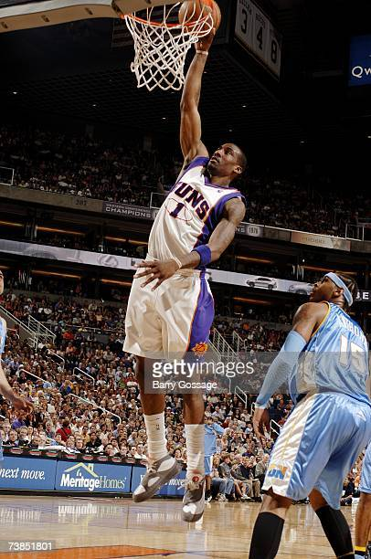 Amare Stoudemire of the Phoenix Suns goes for a dunk against the Denver Nuggets during the game at US Airways Center on March 30 2007 in Phoenix...