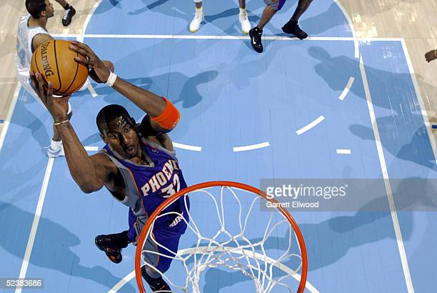 Amare Stoudemire of the Phoenix Suns goes to the basket against the Denver Nuggets on March 13 2005 at the Pepsi Center in Denver Colorado The Suns...