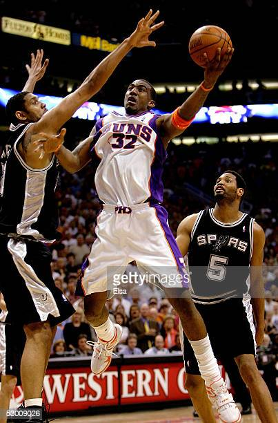 Amare Stoudemire of the Phoenix Suns goes up for a shot against Tim Duncan and Robert Horry of the San Antonio Spurs in Game five of the Western...