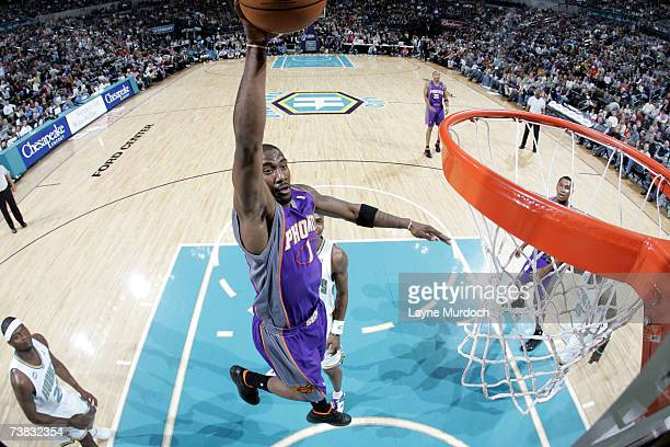 Amare Stoudemire of the Phoenix Suns goes up for dunk against Devin Brown of the New Orleans/Oklahoma City Hornets during a game at the Ford Center...