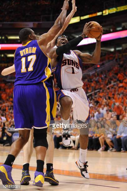 Amar'e Stoudemire of the Phoenix Suns goes up for the shot against Andrew Bynum of the Los Angeles Lakers in Game Six of the Western Conference...