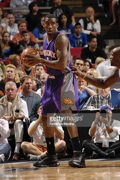 Amare Stoudemire of the Phoenix Suns holds the ball against the Orlando Magic at Amway Arena on November 10 2007 in Orlando Florida NOTE TO USER User...