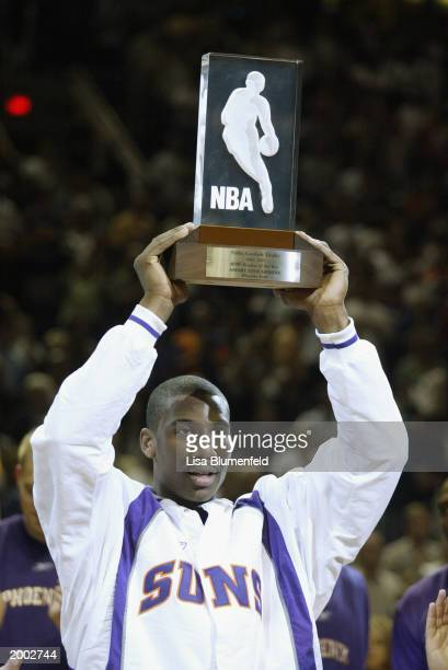 Amare Stoudemire of the Phoenix Suns holds up his 2003 NBA Rookie of the Year Trophy before Game three of the Western Conference Quarterfinals...