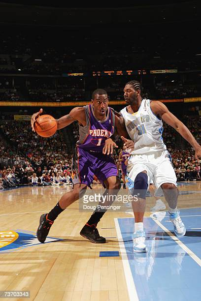 Amare Stoudemire of the Phoenix Suns is defended by Nen #31 of the Denver Nuggets during the game on March 17 2007 at the Pepsi Center in Denver...