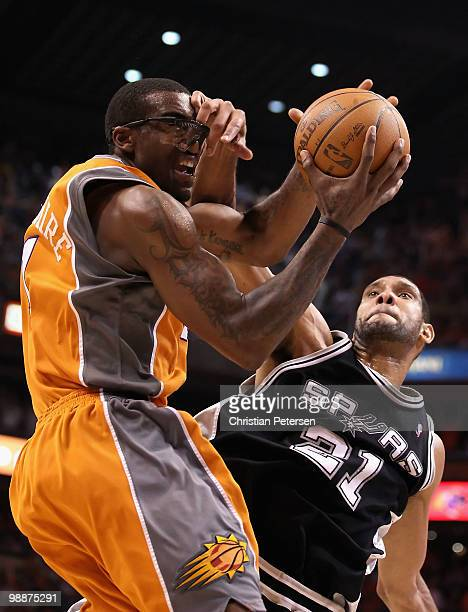 Amar'e Stoudemire of the Phoenix Suns is fouled by Tim Duncan of the San Antonio Spurs as he attempts a shot during Game Two of the Western...