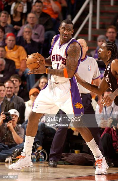 Amare Stoudemire of the Phoenix Suns is guarded by Udonis Haslem of the Miami Heat in an NBA game played on December 10 2007 at US Airways Center in...