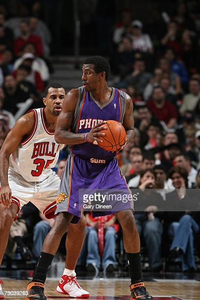 Amare Stoudemire of the Phoenix Suns looks to make a move against Malik Allen of the Chicago Bulls during a game at the United Center on January 2...