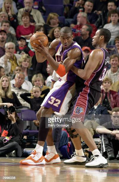 Amare Stoudemire of the Phoenix Suns posts up Jarron Collins of the Utah Jazz during the game at America West Arena on February 7 2004 in Phoenix...