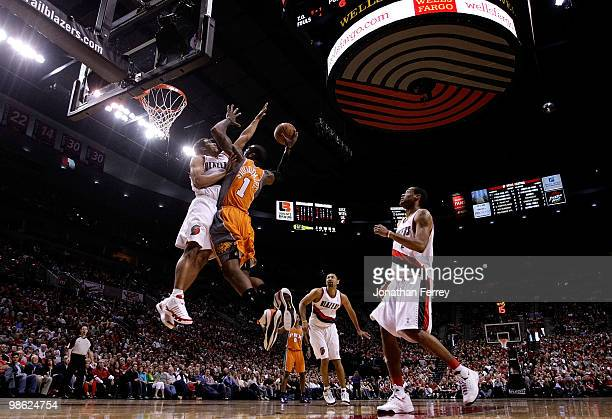 Amar'e Stoudemire of the Phoenix Suns shoots a basket against Andre Miller of the Portland Trail Blazers during Game 3 of the Western Conference...