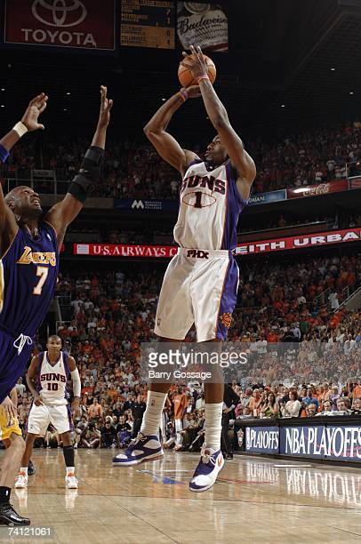Amare Stoudemire of the Phoenix Suns shoots a jump shot over Lamar Odom of the Los Angeles Lakers in Game Five of the Western Conference...
