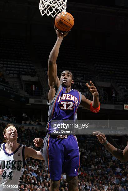 Amare Stoudemire of the Phoenix Suns shoots as Keith Van Horn of the  Milwaukee Bucks looks 99cb61338