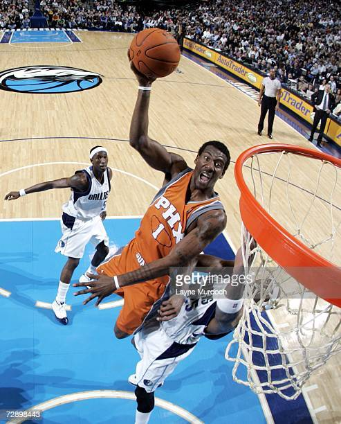 Amare Stoudemire of the Phoenix Suns shoots the ball over Erick Dampier of the Dallas Mavericks during an NBA game on December 28 2006 at the...