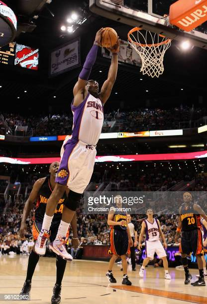 Amar'e Stoudemire of the Phoenix Suns slam dunks the ball against the Golden State Warriors during the NBA game at US Airways Center on January 23...