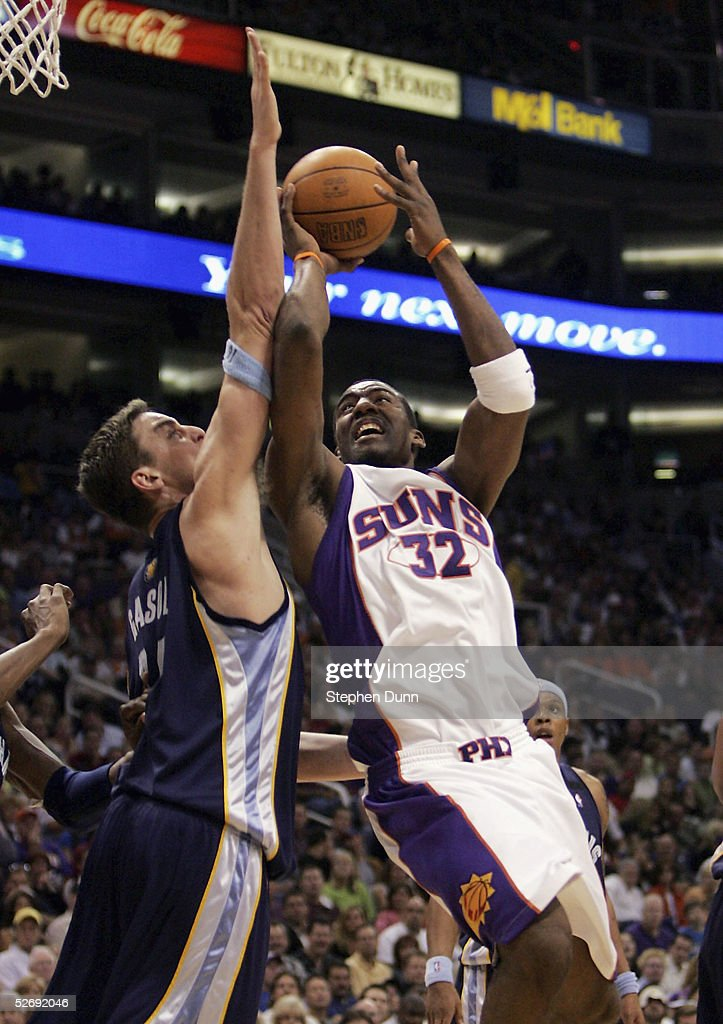 Amare Stoudemire #32 of the Phoenix Suns takes s shot guarded by Pau Gasol #16 of the Memphis Grizzlies in game one of the Western Conference Quarterfinals during the 2005 NBA Playoffs at America West Arena on April 24, 2005 in Phoenix, Arizona. The Suns won 114-103.