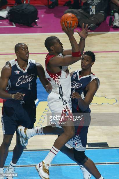 Amare Stoudemire of the Western Conference shoots the ball over Chris Bosh of the Eastern Conference during the 2007 NBA AllStar Game on February 18...