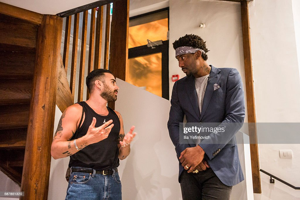 Amar'e Stoudemire speaks with other guests during a contemporary art exhibition at Ana Tiho center on August 9, 2016 in Jerusalem, Israel. Stoudemire, who has played for the Phoenix Suns, New York Nicks, Dallas Mavericks, and Miami Heat, retired from the NBA recently to play for Hapoel Jerusalem.