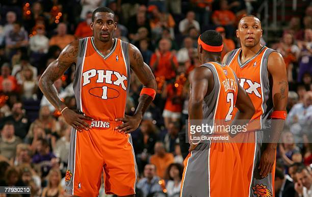 Amare Stoudemire stands with teammates Marcus Banks and Shawn Marion of the Phoenix Suns during a time out against the Los Angeles Lakers at US...