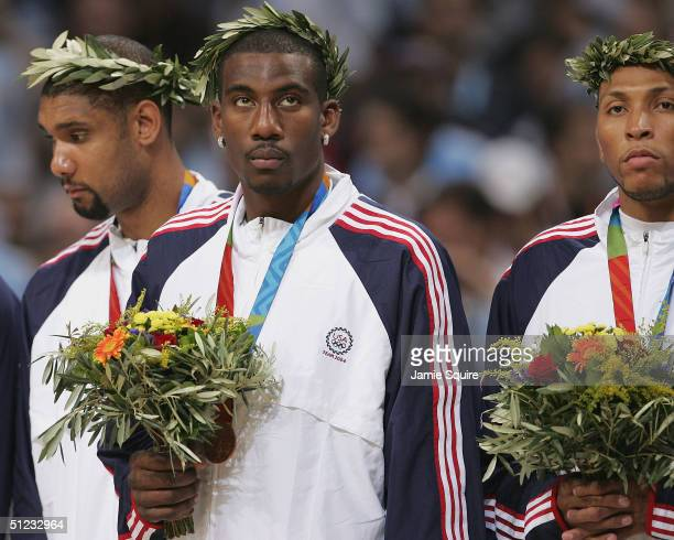 Amare Stoudemire Tim Duncan and Shawn Marion of the United States receive the bronze medal for men's basketball during ceremonies on August 28 2004...