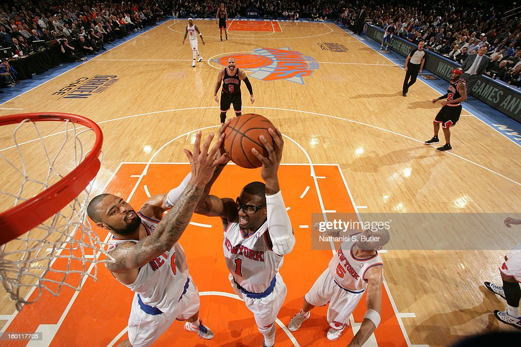 Amare'e Stoudemire #1 and Tyson Chandler #6 of the New York Knicks go up for a rebound against the Chicago Bulls on January 11, 2013 at Madison Square Garden in New York City.
