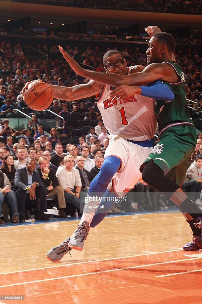 Amare'e Stoudemire #1 of the New York Knicks drives against Larry Sanders #8 of the Milwaukee Bucks on February 1, 2013 at Madison Square Garden in New York City .
