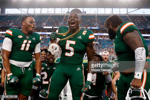 Amari Carter of the Miami Hurricanes celebrates with the Turnover Chain after intercepting a pass from Chase Brice of the Appalachian State...