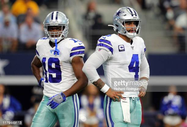 Amari Cooper and Dak Prescott of the Dallas Cowboys stand on the field in the first quarter against the Green Bay Packers at AT&T Stadium on October...