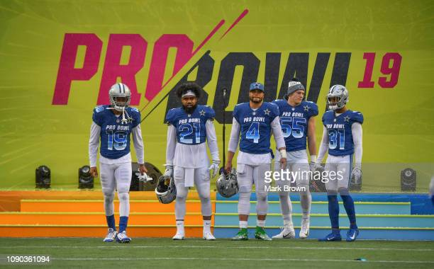 Amari Cooper Ezekiel Elliott Dak Prescott Leighton Vander Esch#55 and Byron Jones of the Dallas Cowboys get introduced before the 2019 NFL Pro Bowl...