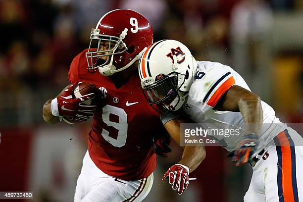 Amari Cooper of the Alabama Crimson Tide catches a pass in the fourth quarter against the Auburn Tigers during the Iron Bowl at BryantDenny Stadium...