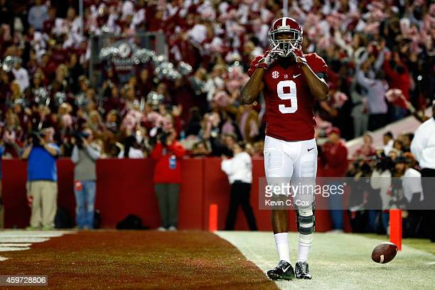 Amari Cooper of the Alabama Crimson Tide celebrates after catching a 39 yard touchdown pass thrown by Blake Sims in the third quarter against the...