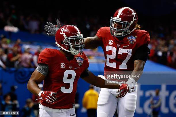 Amari Cooper of the Alabama Crimson Tide celebrates with his teammate Derrick Henry after scoring touchdown in the first quarter against the Ohio...