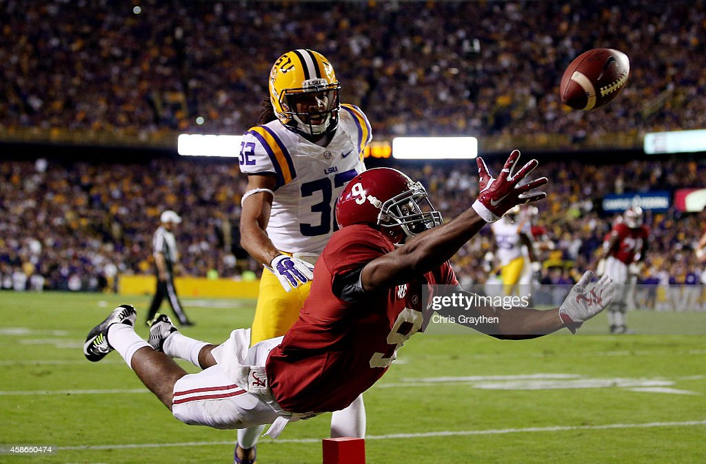 Amari Cooper #9 of the Alabama Crimson Tide fails to make a catch in the second quarter as Jalen Collins #32 of the LSU Tigers defends during a game at Tiger Stadium on November 8, 2014 in Baton Rouge, Louisiana.