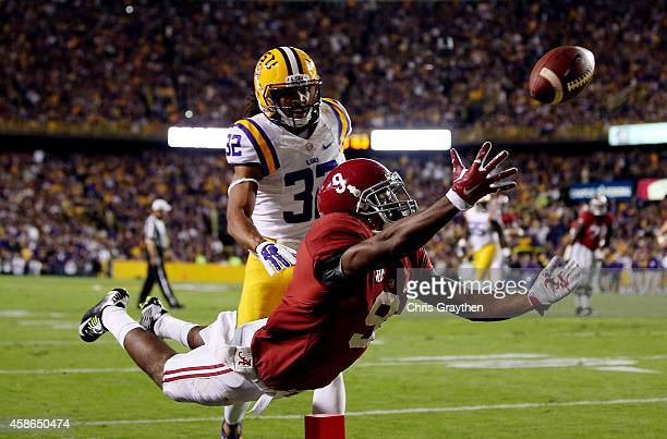Amari Cooper of the Alabama Crimson Tide fails to make a catch in the second quarter as Jalen Collins of the LSU Tigers defends during a game at...