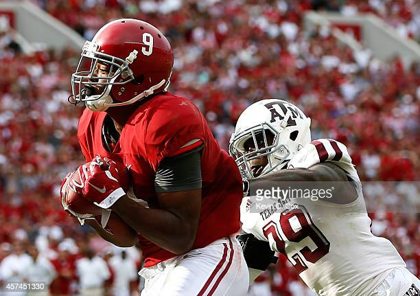Amari Cooper of the Alabama Crimson Tide pulls in this reception for a touchdown against Deshazor Everett of the Texas AM Aggies at BryantDenny...