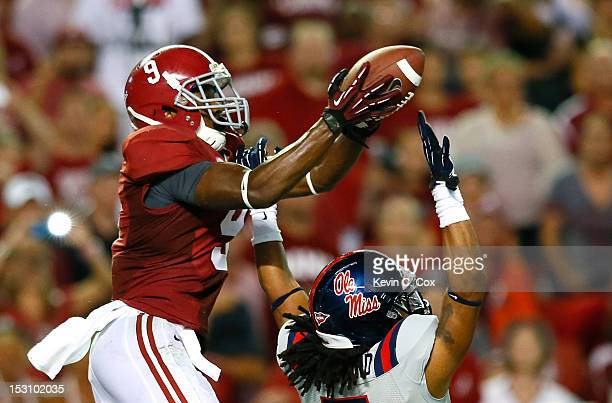 Amari Cooper of the Alabama Crimson Tide pulls in this touchdown reception over the hands of Frank Crawford of the Mississippi Rebels at BryantDenny...