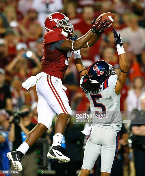 Amari Cooper of the Alabama Crimson Tide pulls in this touchdown reception over the hands of Frank Crawford of the Mississippi Rebels at Bryant-Denny...